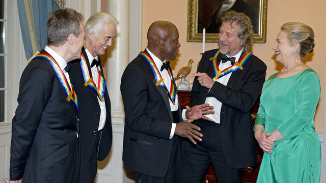 John Paul Jones, Jimmy Page, Buddy Guy and Robert Plant alongside US Secretary of State Hillary Clinton in Washington for the Kennedy Center Honors
