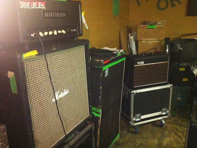 Matchless 120 Super Chief, Marshall cabinet (two are used), Ampeg bass amp, Vox AC15 combo amp.