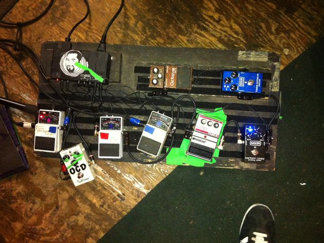 Bottom row, left to right: Boss Chromatic Tuner used for switching the Matchless, OCD distortion pedal, Boss tuner used for switching the Vox, Boss tuner for switching the Ampeg, DOD phaser, MXR Carbon Copy delay. Top row, left to right: Boss octave pedal for the bass pickup, MXR bass octave pedal.