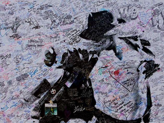 Fans have been signing a Michael Jackson memorial poster outside The Staples Centre.