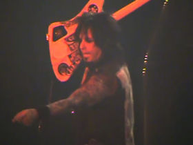 Motley Crue's Nikki Sixx spits at female fan