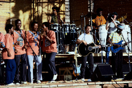 Paul simon performs with his band on the graceland tour in 1987