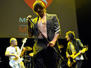 Fellow Chili Peppers and Ron Wood salute Anthony Kiedis