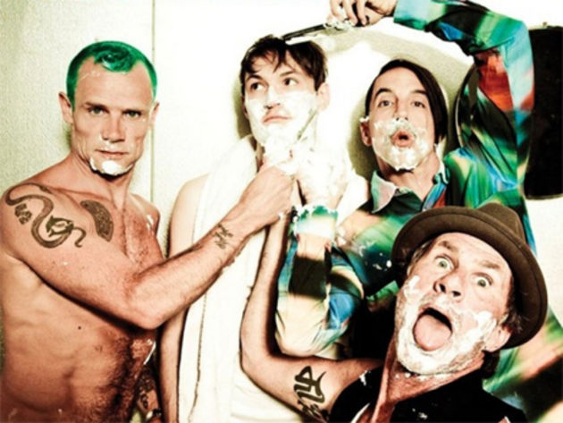 Flea (left) discusses what Josh Klinghoffer (center) brings to the Chili Peppers