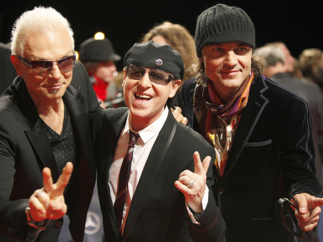 Rudolf Schenker, Klaus Meine and Matthias Jabs contemplate bridge and shuffleboard