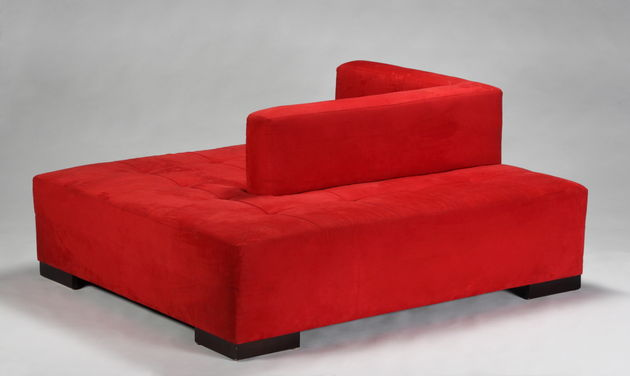 Lot 335: Two monumental red suede conversation sofas