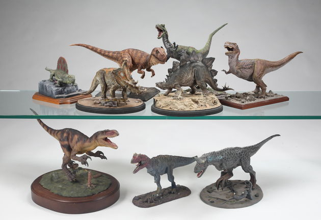 Lot 397: One of five groups of replica dinosaur models