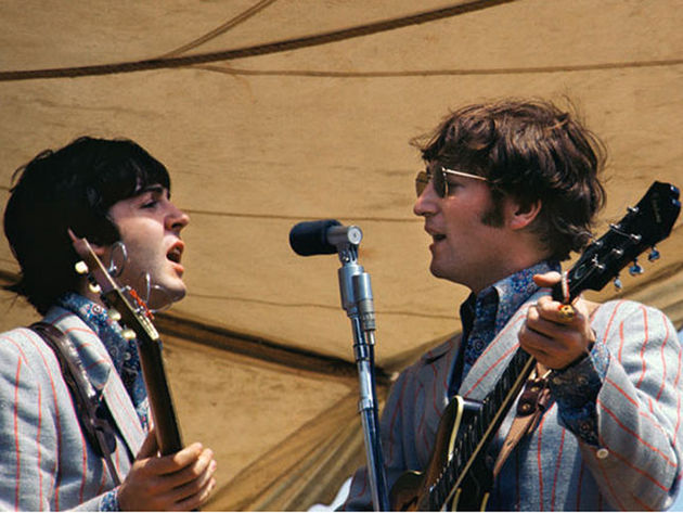 Paul and John share a mic in '66