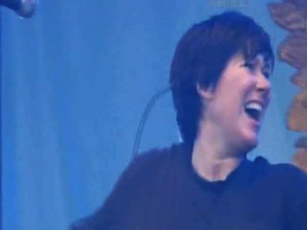 Kim Deal is one happy girl during Pixies' Isle Of Wight set