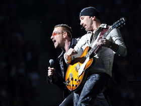 "U2 reschedule tour dates, post video: ""We're coming back"""