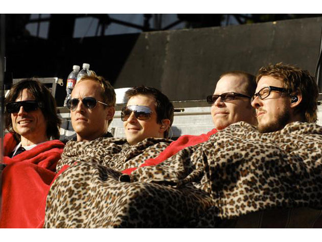 Weezer get snuggly with Josh Freese (second from left)