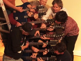 VIDEO: Eight men play Crossroads on an 8-necked guitar