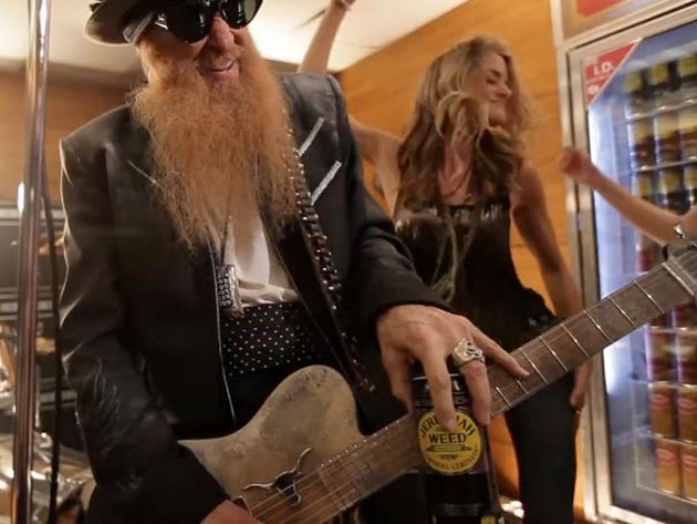 Billy Gibbons slides around with a friend