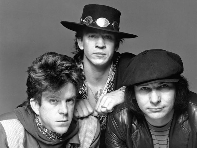 Stevie Ray flanked by Double Trouble, Chris Layton (left) and Tommy Shannon (right)