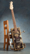 Made from a First Act Strat-copy neck and two Tabak cigar boxes