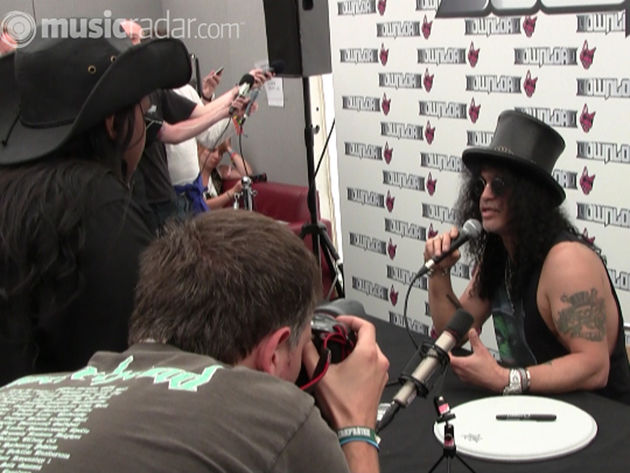 Slash answering questions from reporters backstage at Download 2010