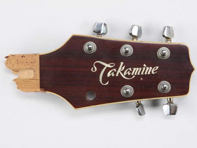 Bruce Springsteen broken Takamine headstock