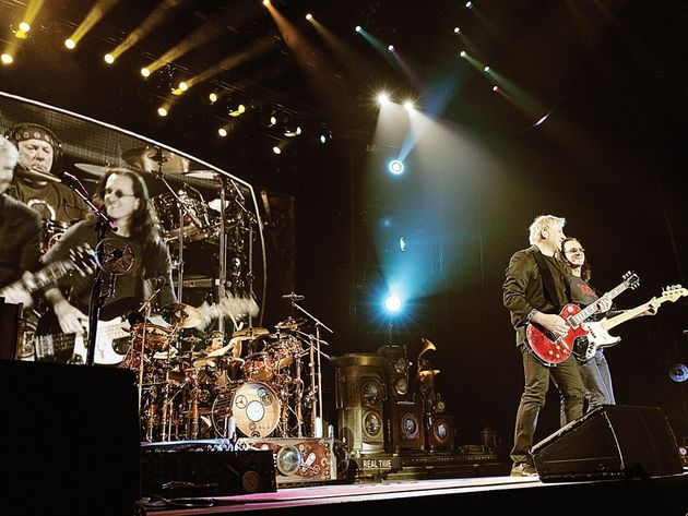 Rush perform onstage as part of their recent Time Machine tour.