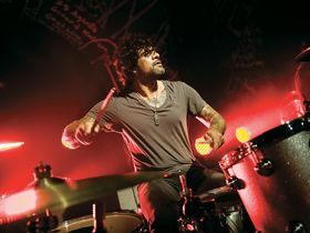 Joey Castillo talks punishing schedules with QoTSA and Eagles of Death Metal
