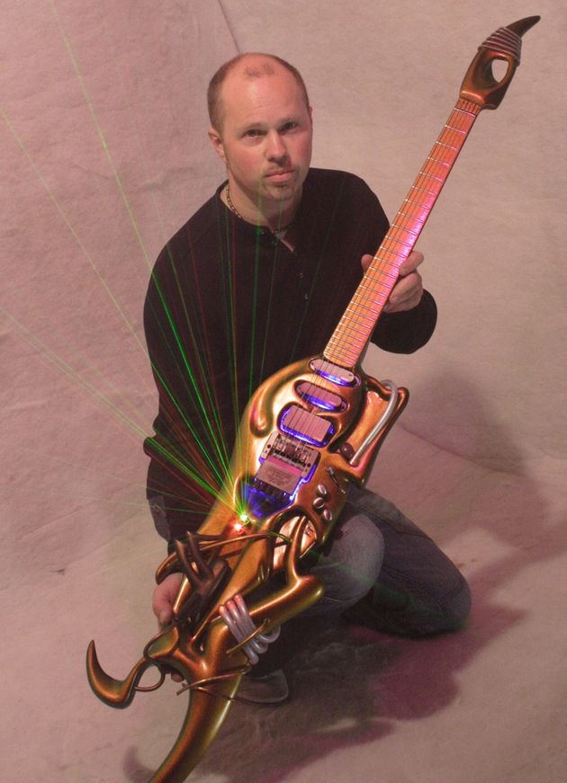 Designer Alister Hay with the Ultra guitar