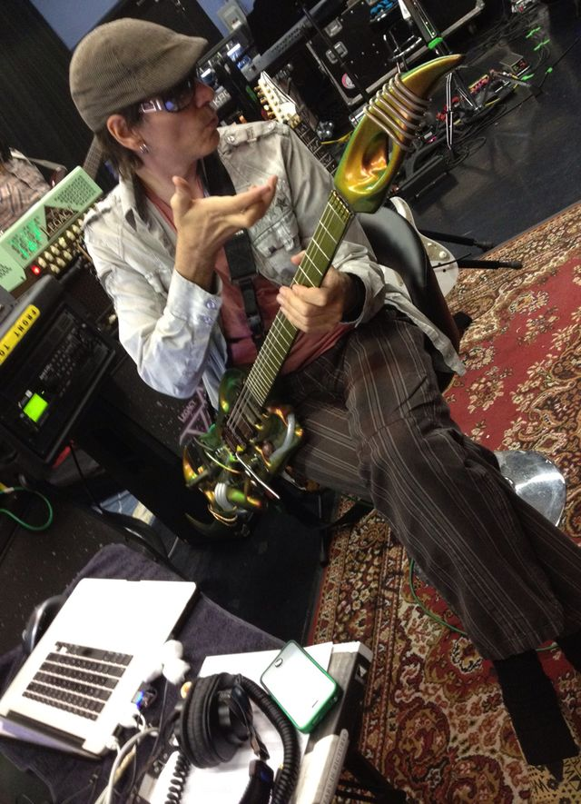 Steve Vai vibes out in rehearsal with his Ultra guitar