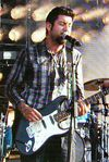 Deftones singer Chino Moreno also took on guitar duty for a few songs in their set, here with a humbucker-loaded Strat.