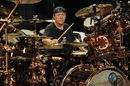 Win signed Neil Peart DVD and Remo head