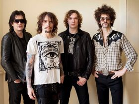 The Darkness play hometown show, debut new songs