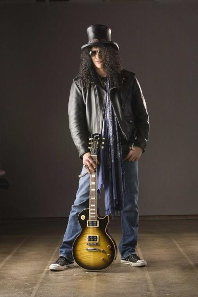 Ronnie wood gave slash guitar lessons