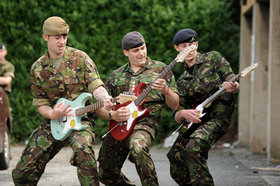 Soldiers with guitars