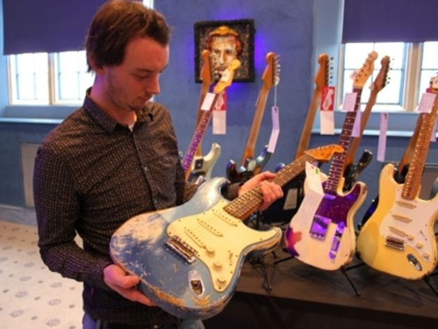 Stu examining a 1962 Heavy Relic Stratocaster